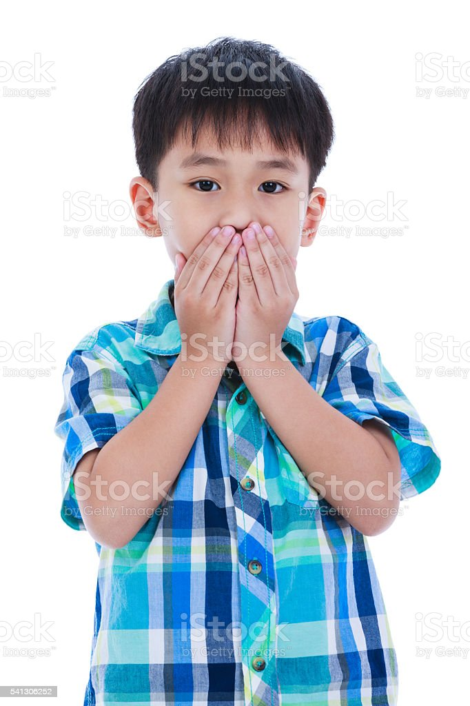 Asian boy covering his mouth. Isolated on white background. - foto de acervo