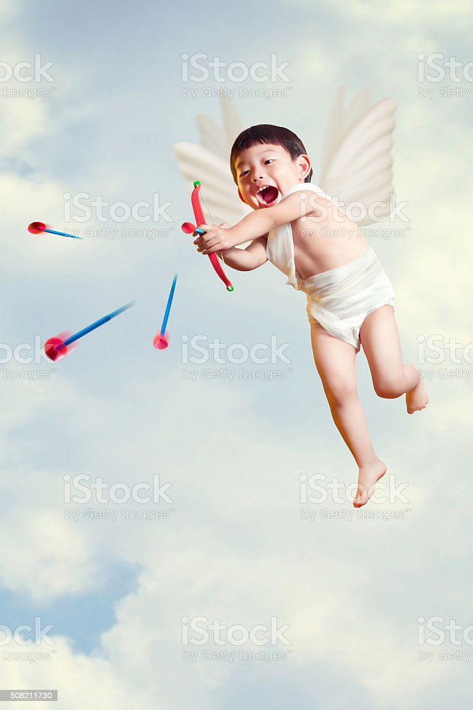 asian boy cupid fly with a bow and arrows stock photo