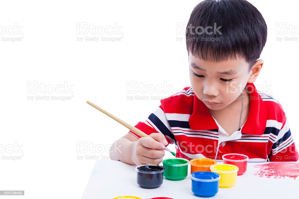 Asian boy draw image using drawing instruments, creativity conce stock photo