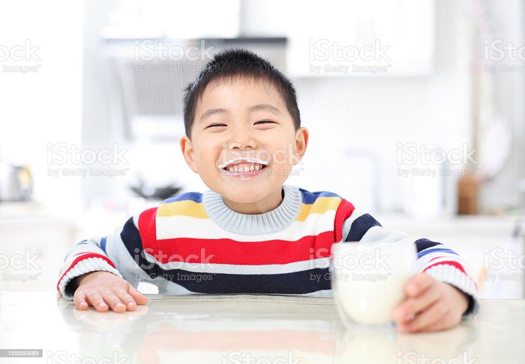 Asian boy drinking milk royalty-free stock photo