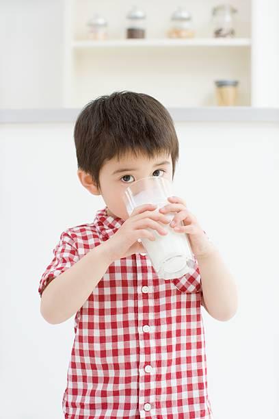 Asian boy drinking milk stock photo