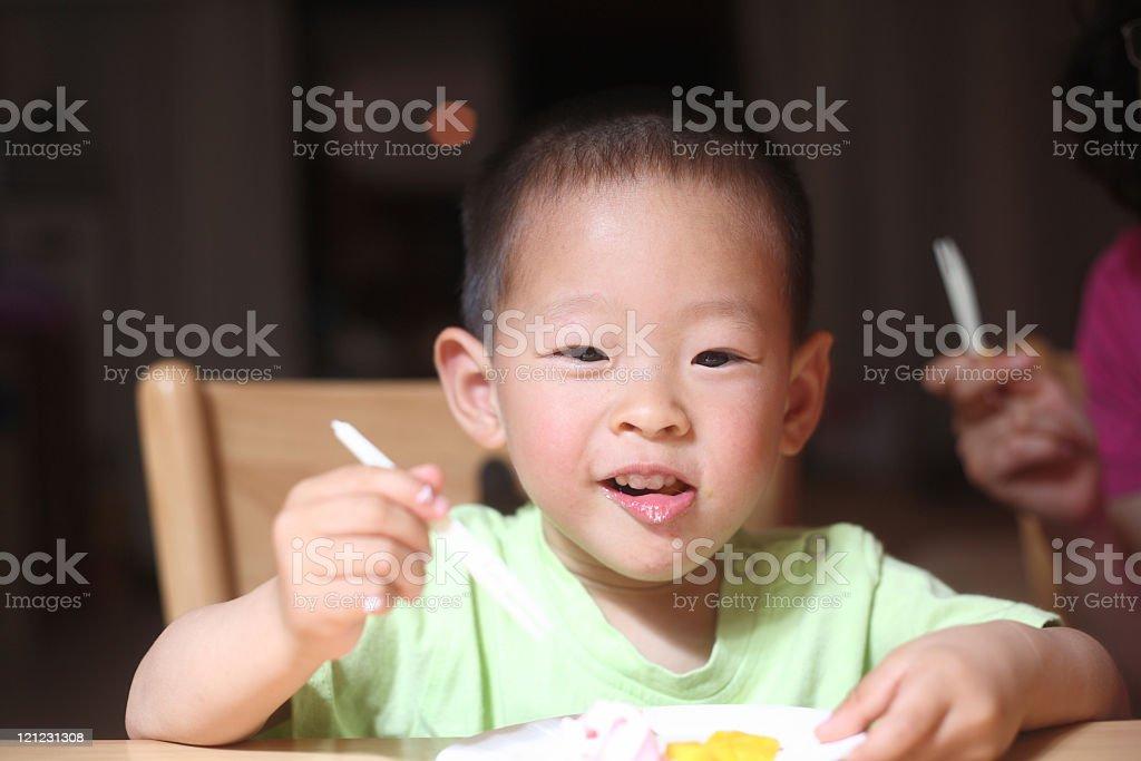 asian boy eating stock photo