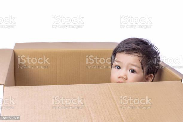 Asian boy hidden in a box of parcels on isolate white background with picture id882772626?b=1&k=6&m=882772626&s=612x612&h=zxff3ccepujgdg4hamxgpwcdvclu5suxz  pd3xrkdw=