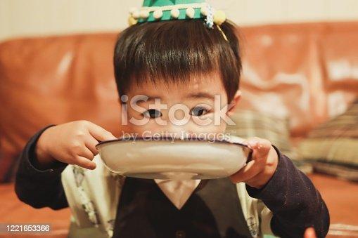 Asian boy enjoy dinner at home