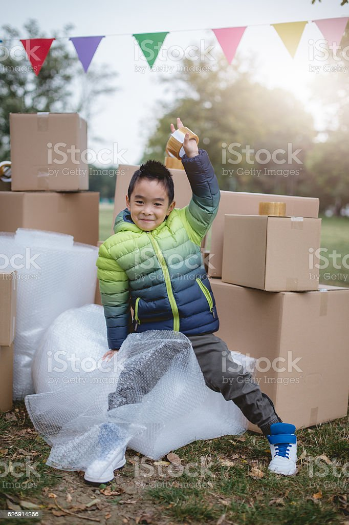 asian boy holind duck tape stock photo