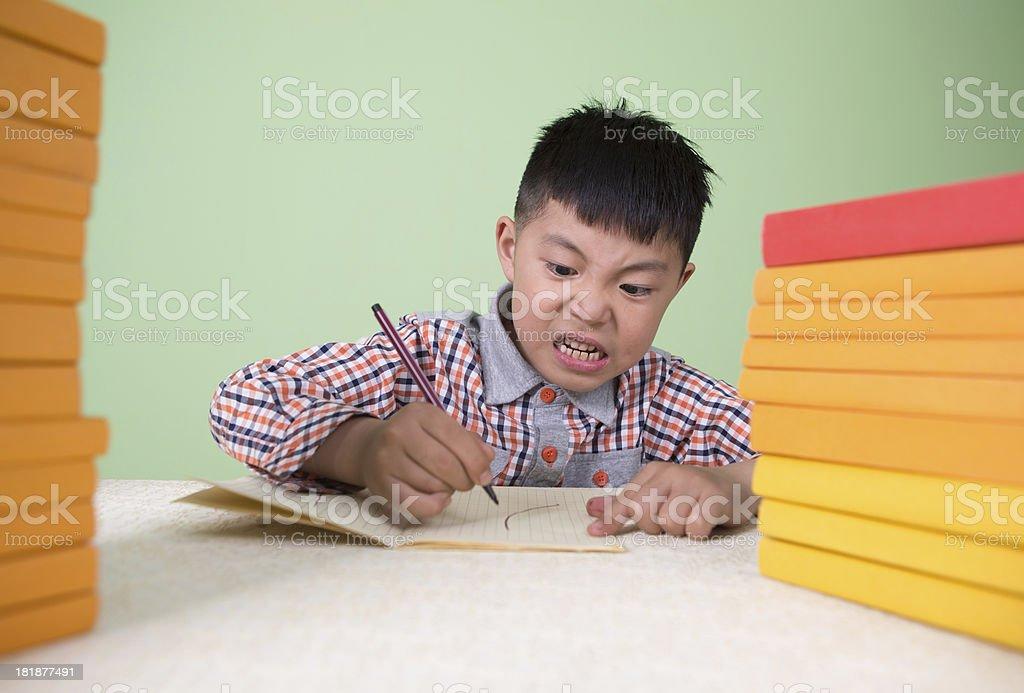 asian Boy homework at home royalty-free stock photo