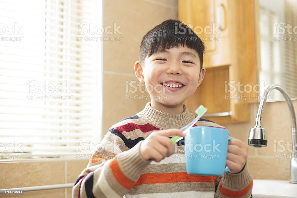 Asian boy in the bathroom washing royalty-free stock photo