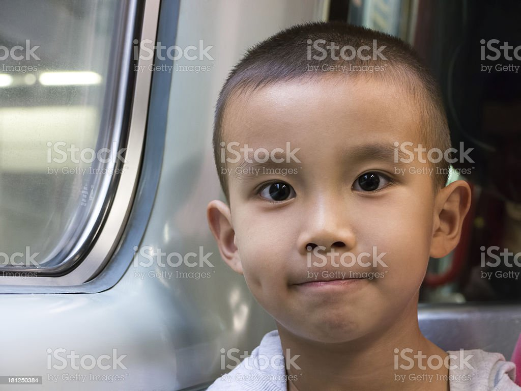 Asian boy in the train royalty-free stock photo