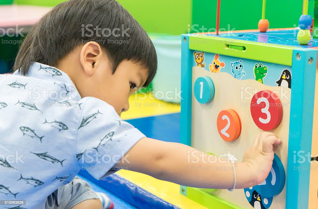 Asian Boy is playing counting educational toy stock photo