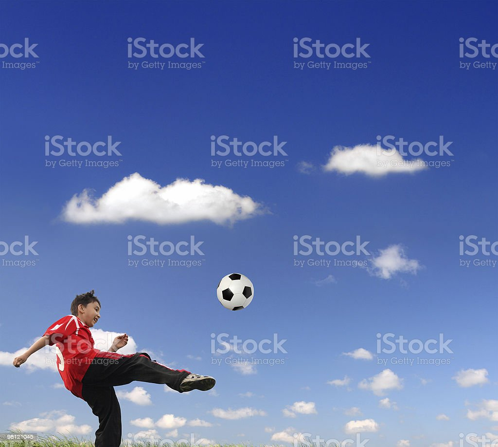 asian boy playing football royalty-free stock photo