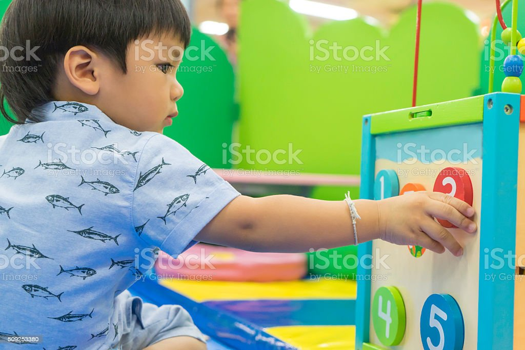 Asian Boy playing with Educational toys stock photo