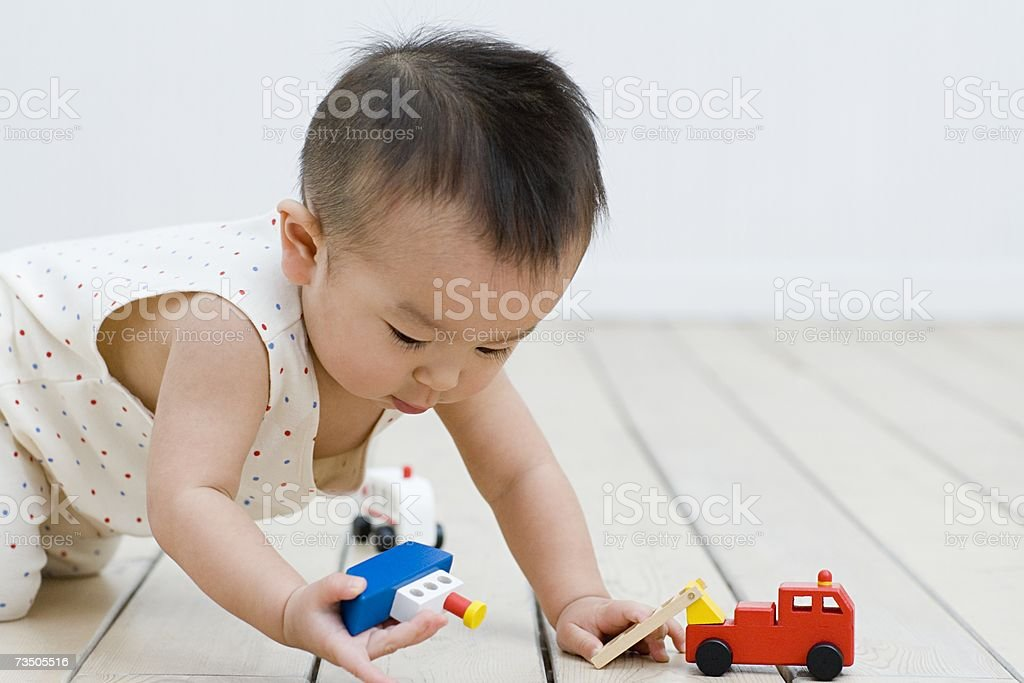 Asian boy playing with toys royalty-free stock photo