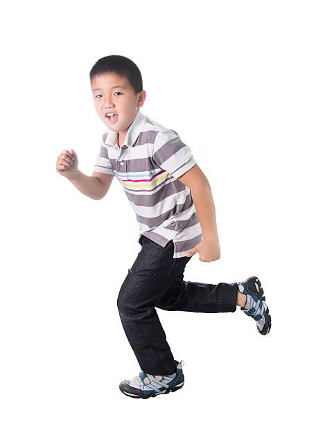Asian boy running, isolated on white background stok fotoğrafı
