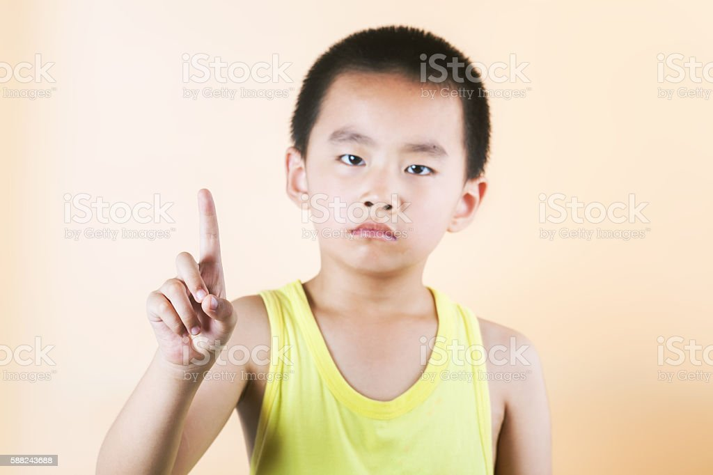 asian boy standing infront of  orange background stock photo