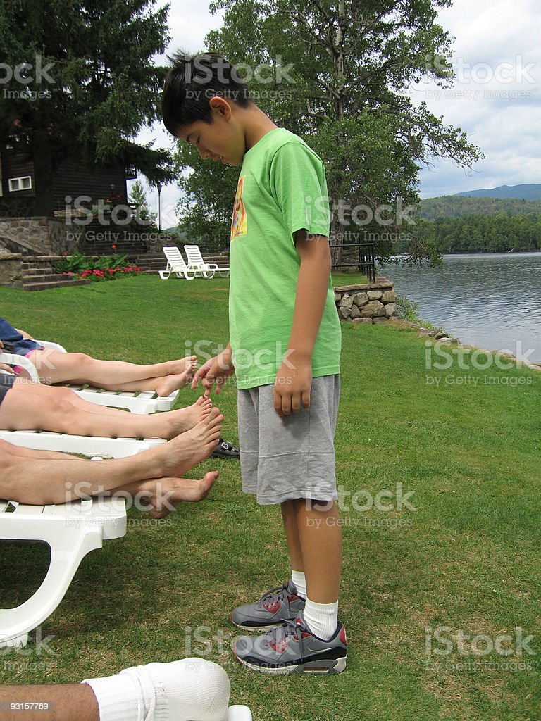 Asian Boy Tickling Feet stock photo