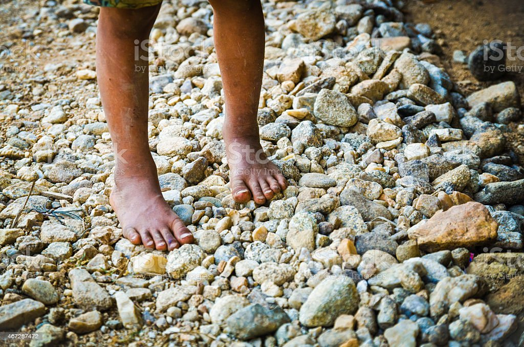 asian boy tribe feet in Mae Sod,Thailand stock photo