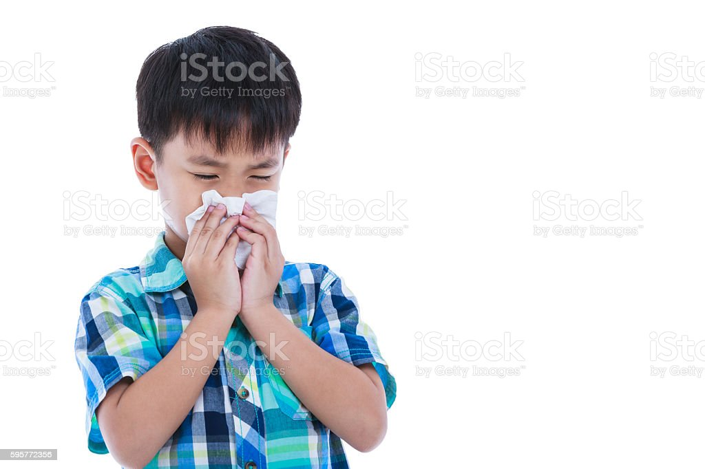 Asian boy using tissue to wipe snot. Isolated on white. stock photo