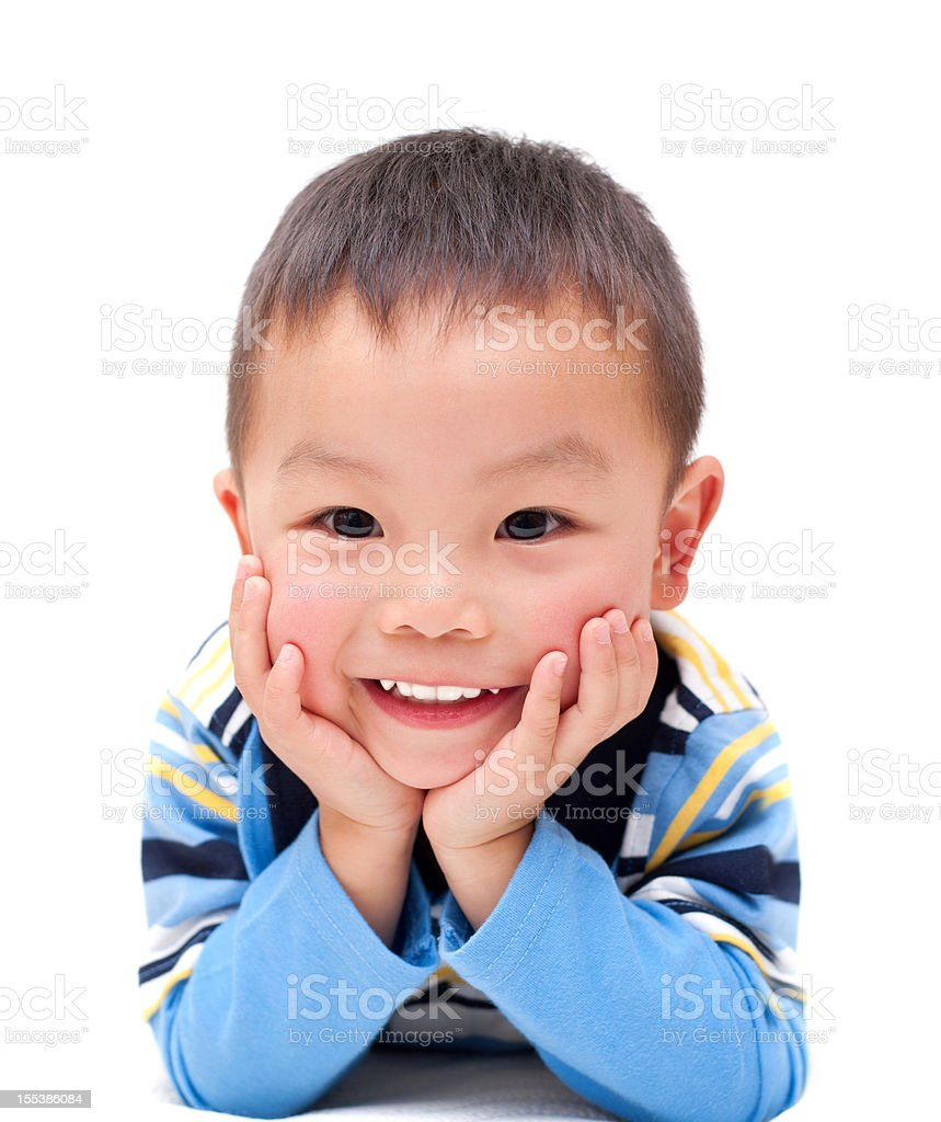 Asian boy with happy smile isolated on white background stock photo