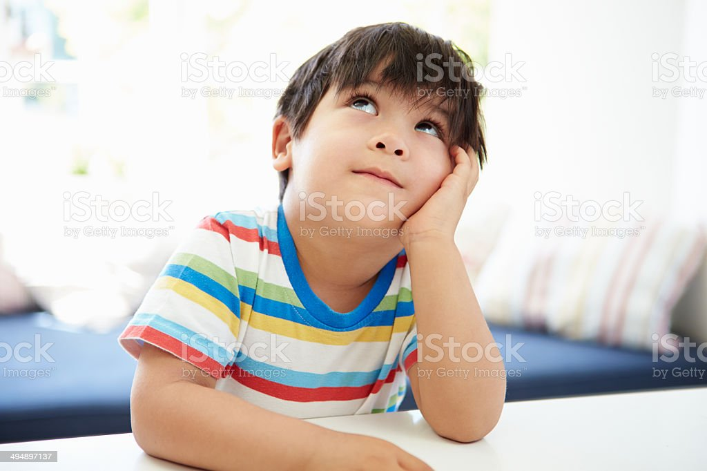 Asian Boy With Head In Hands Thinking stock photo