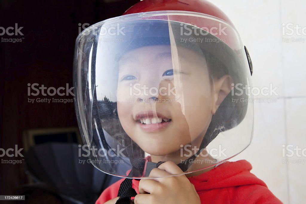asian boy with helmet royalty-free stock photo