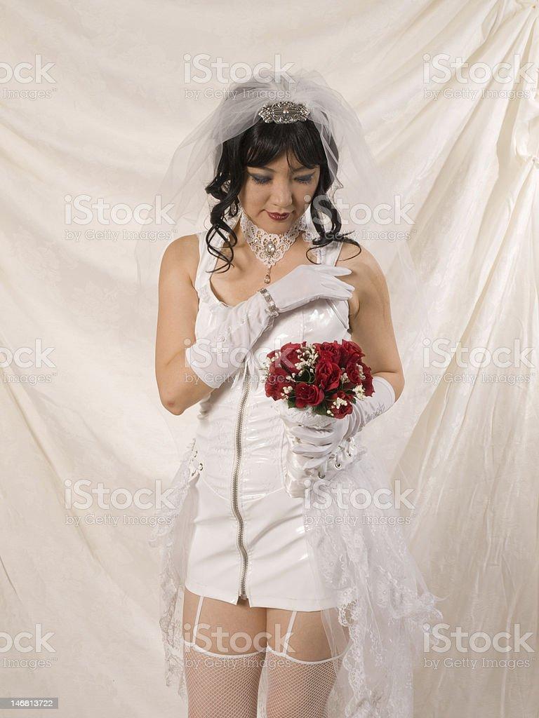 PVC Asian Bride, adjusting shoulder strap stock photo
