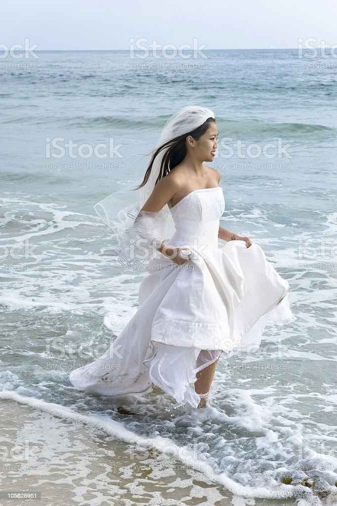 Asian bride at beach royalty-free stock photo