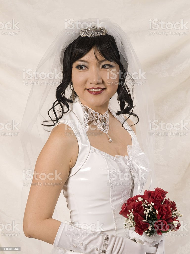 PVC Asian Bride - looking over shoulder to her right stock photo