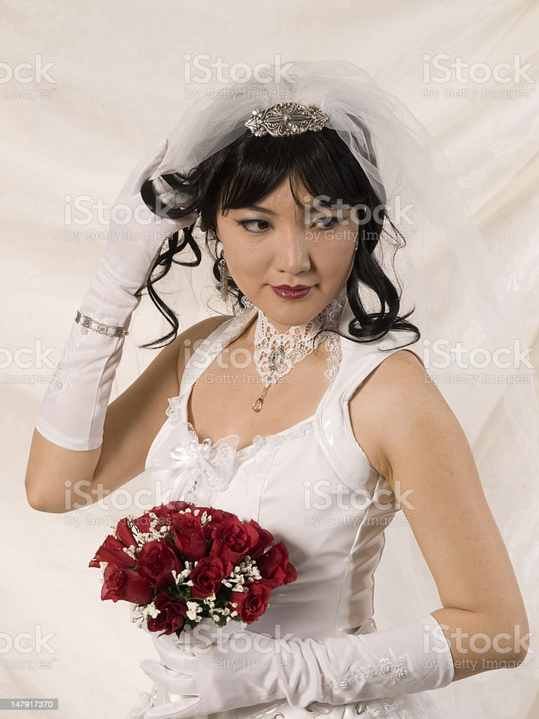 PVC Asian Bride, looking to her left stock photo