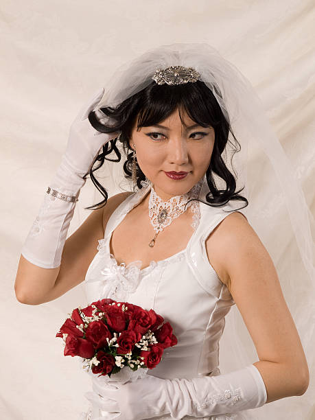 PVC Asian Bride, looking to her right stock photo