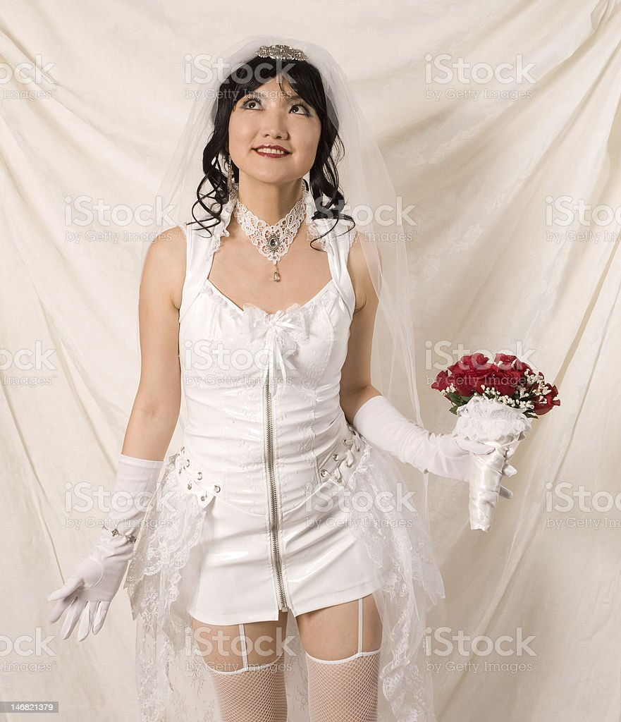 PVC Asian Bride - looking up stock photo