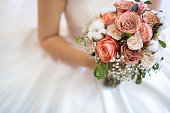 istock Asian bride with flower bouquet 1187074682