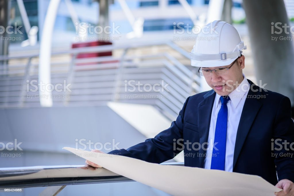 Asian business and engineer man has planning and working for design buiding and city. zbiór zdjęć royalty-free