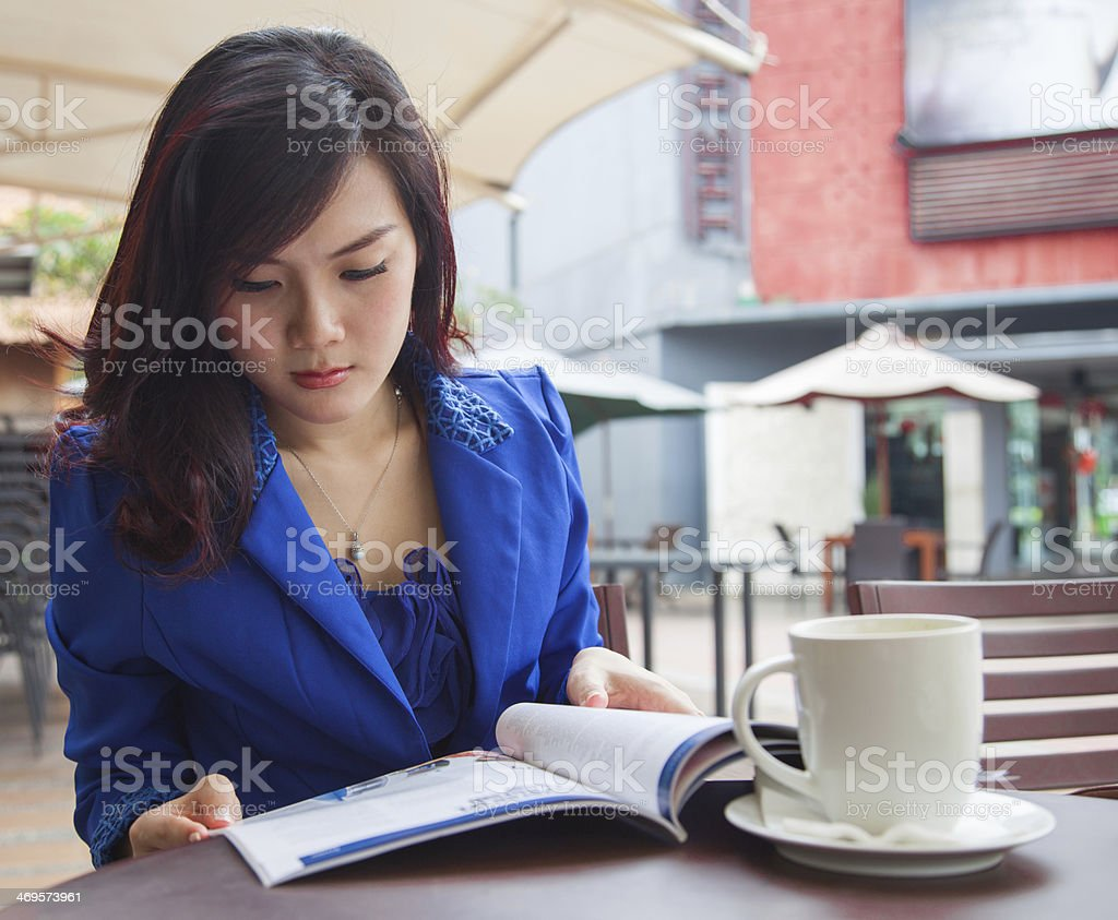 Asian Business Chinese Woman reading magazine stock photo