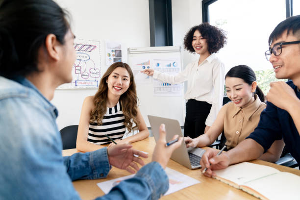 Asian business employee team brainstorming and workshop at meeting room modern workplace.Happy asia creative teamwork group thinking and working together with startup project.Workshop together concept stock photo