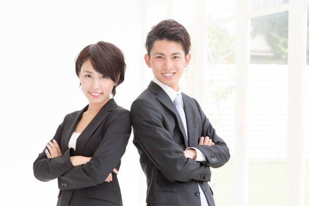 asian business group working asian business group working only japanese stock pictures, royalty-free photos & images