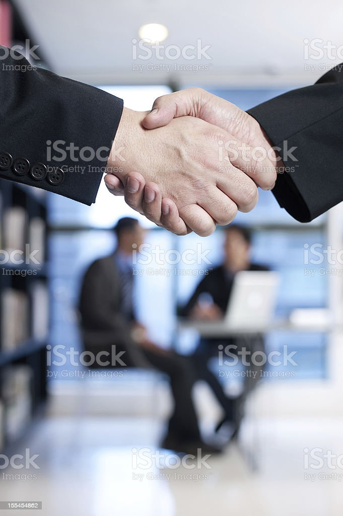 Asian Business Handshake royalty-free stock photo