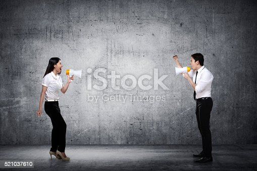 istock Asian business man and woman shout each other 521037610
