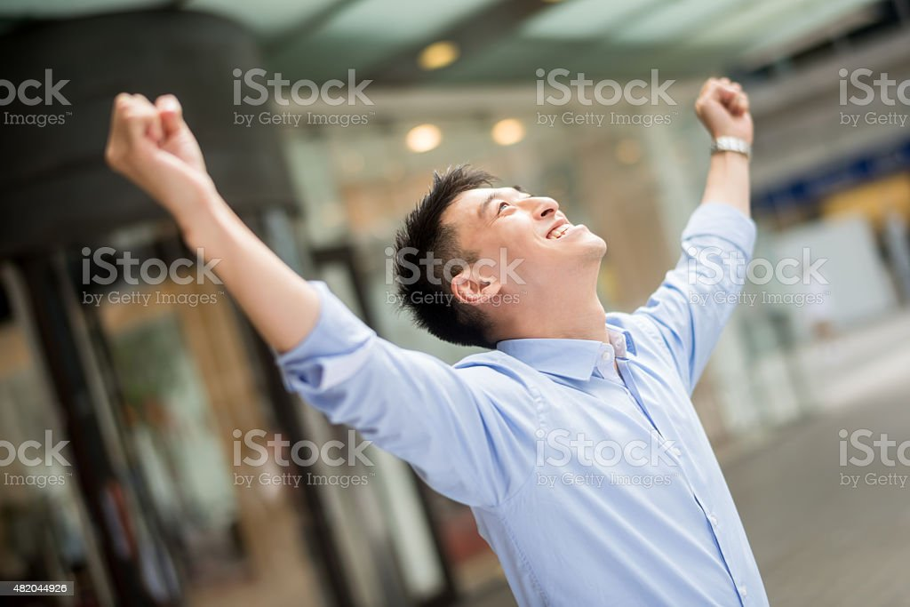Asian business man celebrating a promotion stock photo