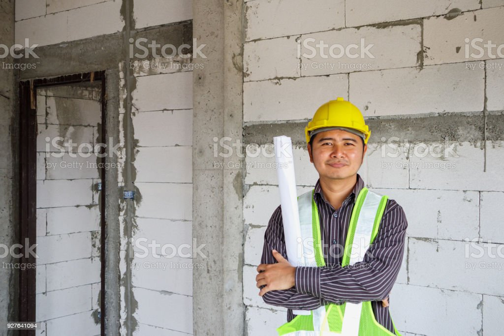 Asian business man construction engineer worker at house building site stock photo