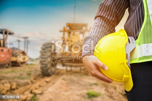 istock Asian business man construction engineer worker with yellow protective helmet at construction site 923099718