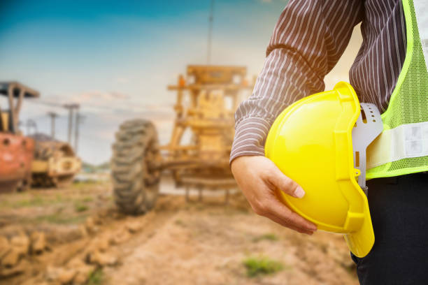 Asian business man construction engineer worker with yellow protective helmet at construction site stock photo