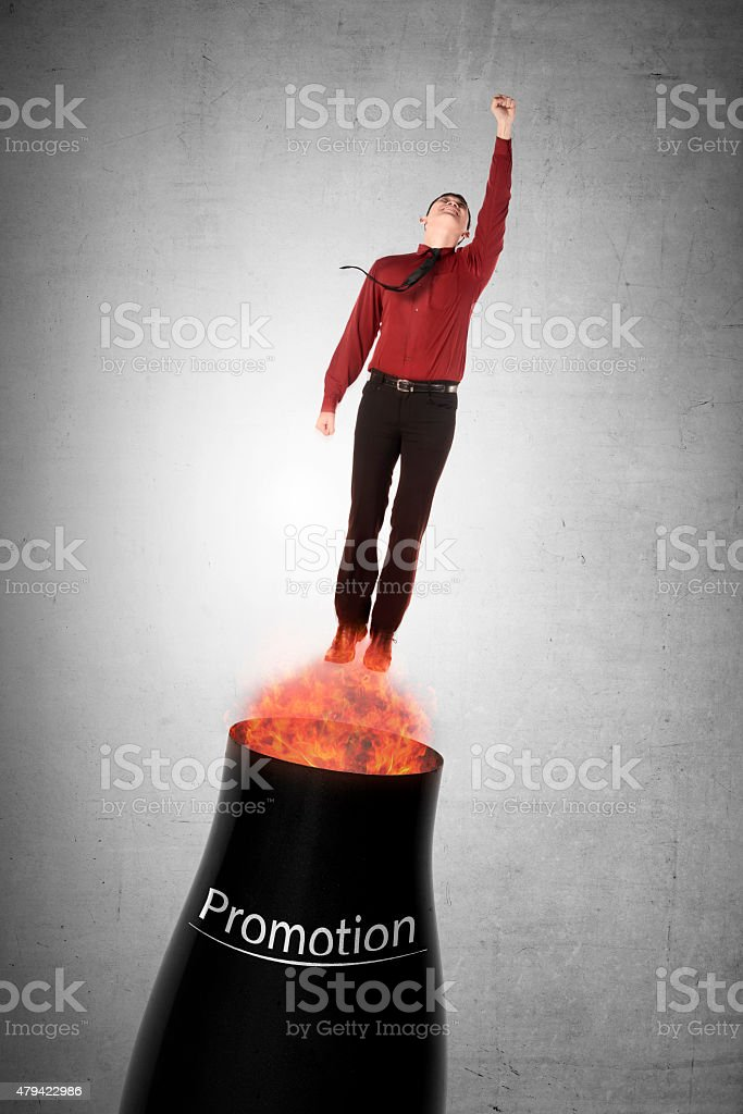 Asian business man flying from cannon stock photo