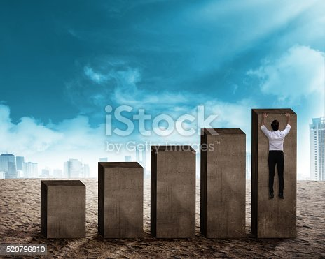 904389218istockphoto Asian business man hanging on the chart 520796810