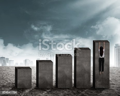 Asian business man hanging on the chart. Forecasting business concept