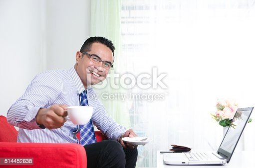 istock Asian business man holding coffee cup and smile, Selective focus 514452638