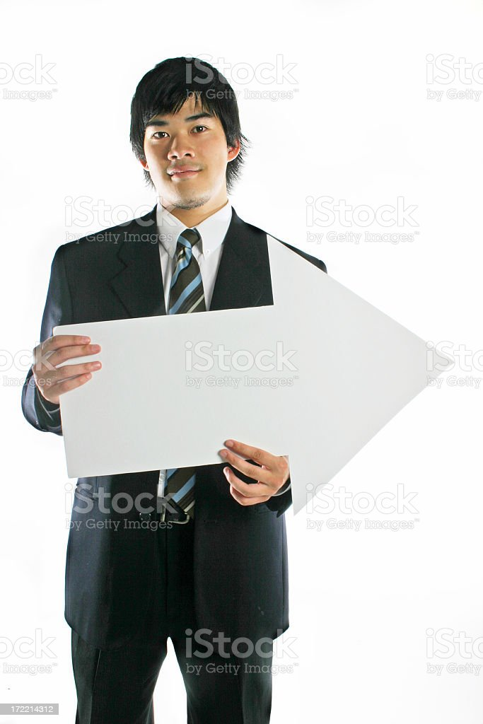 Asian business man holds arrow royalty-free stock photo