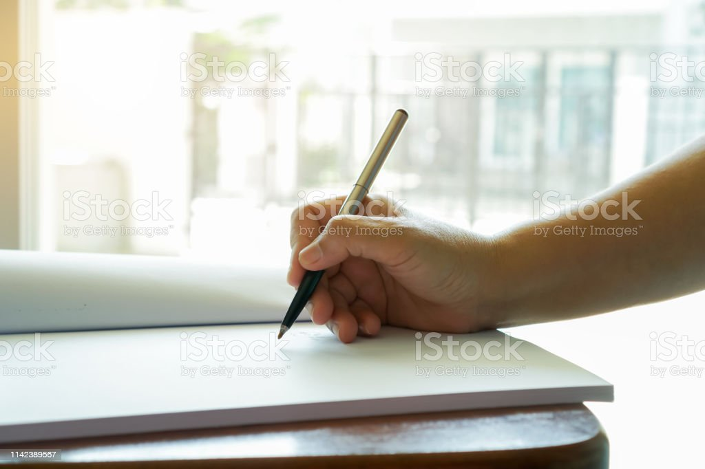 Asian Business man Manager checking and signing applicant filling documents reports papers company application form or registering claim on desk office. Document Report and business busy Concept stock photo