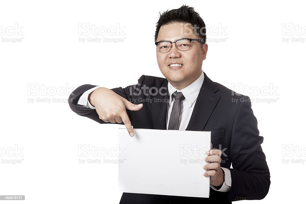 Asian business man point to a blank sign and smile stock photo