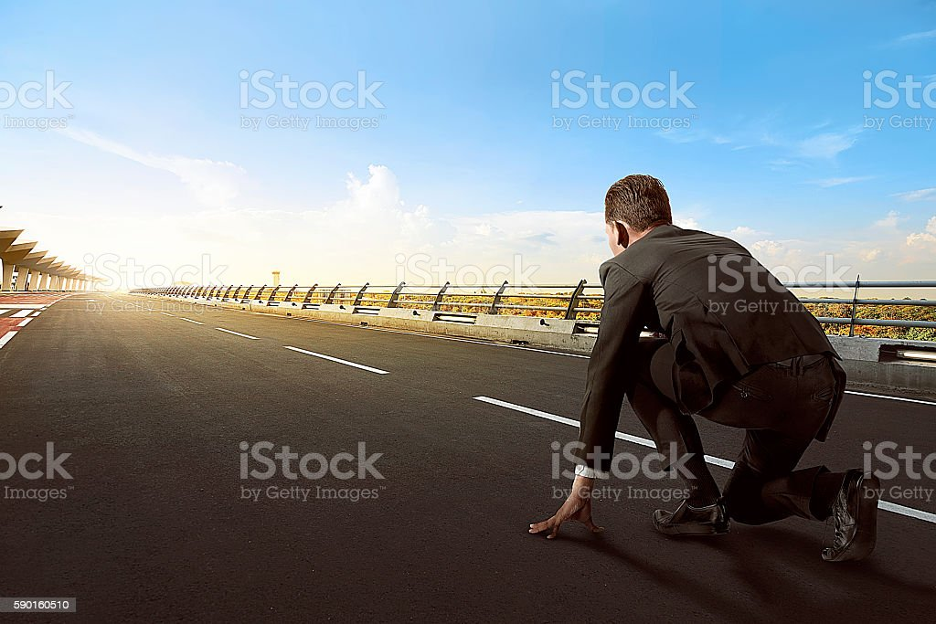 Asian business man ready to run stock photo