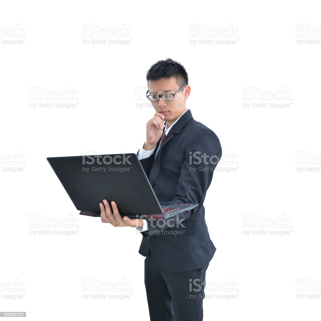 Asian Business man thinking while using laptop computer isolated on white background, clipping path inside royalty-free stock photo